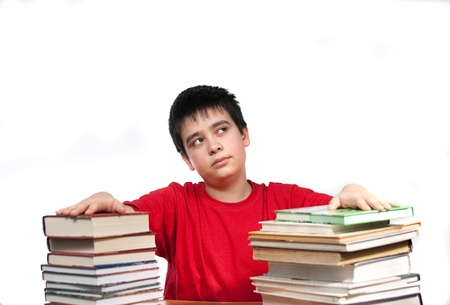 boy prepares lesson of literature photo