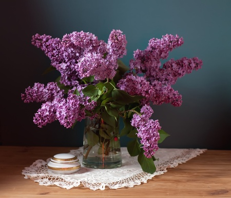 antique vase: still life with lilac flowers