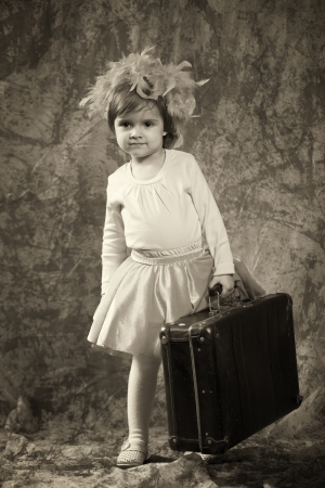 Lonely girl with suitcase photo