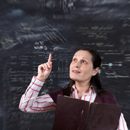 conducts: young woman  teacher conducts a lesson from the school board  Stock Photo