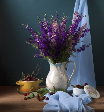 Still life with wild flowers and cherries Stock Photo - 17589332