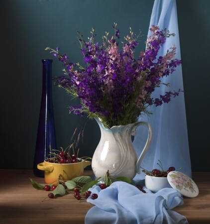 Still life with wild flowers and cherries