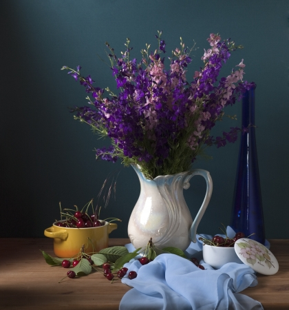 Still life with wild flowers and cherries Stock Photo - 17589331