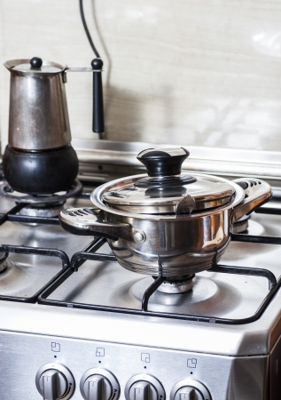 Metal pan on the gas stove in the kitchen photo