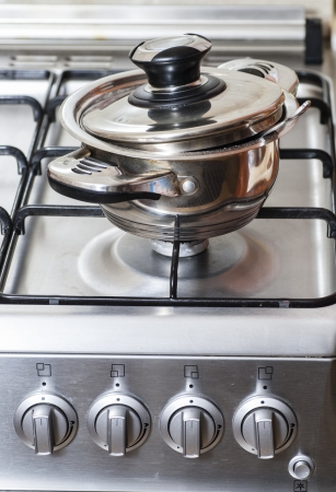 Metal pan on the gas stove in the kitchen Stock Photo - 25203257