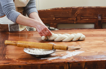Chef preparing dough in a kitchen photo