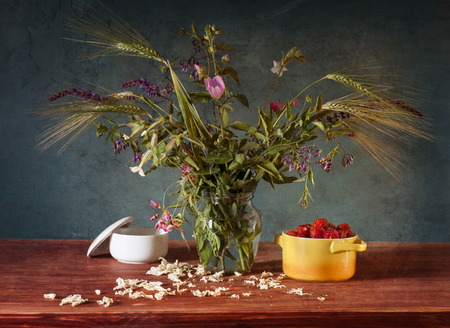still life with wheat ears and wild flowers photo