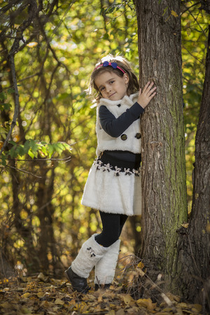 Portrait of a little girl in park photo