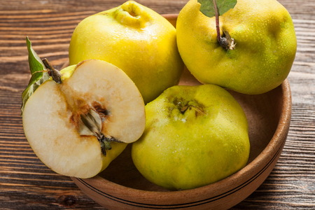 membrillo: quince on vintage wooden background