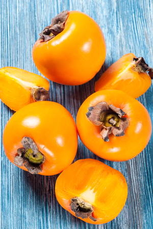 Persimmon fruit on rustic table in vintage style Stock Photo