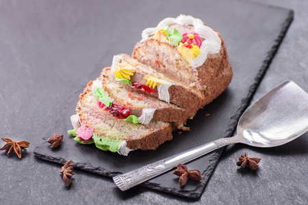 Birthday sweet cake on a black stone table