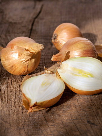 onions on a old wooden table, rustic style