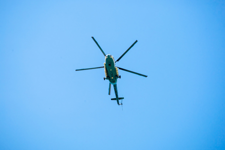 Helicopter flying in the blue sky. Passenger helicopter.
