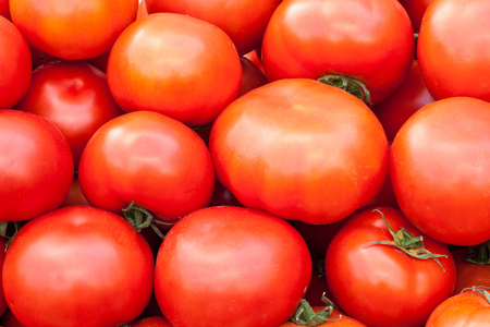 Deliciou red tomatoes. Summer tray market agrigulture farm.