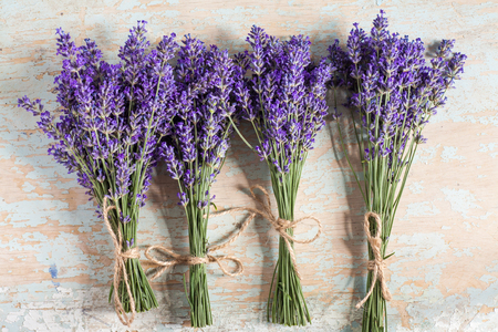 bunch of lavander on old wooden background.