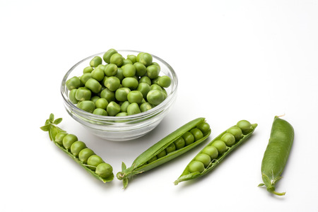 Fresh green pea in glass bowl isolated on white background.