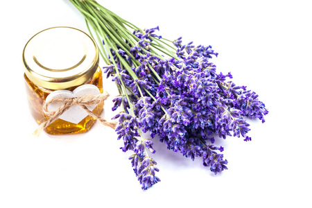Lavander with aromatic oil isolated on white background.