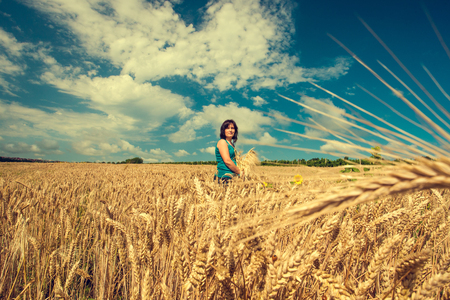 Woman in wheat field. Toned. photo