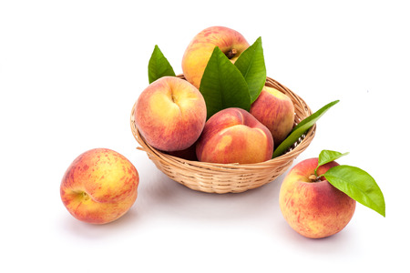 Peaches in bowl isolated on white background