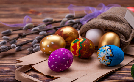 Handmade colored easter eggs on brown wooden table Stock Photo