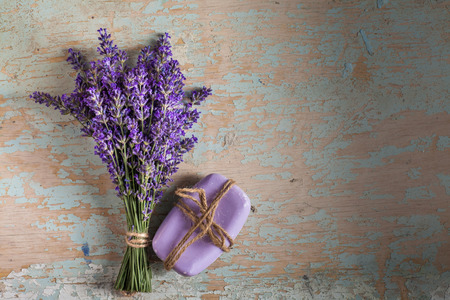 Lavander and soap on old wooden background Stock Photo