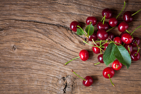 Fresh cherry on wooden background. vegetarian food. Summer time.