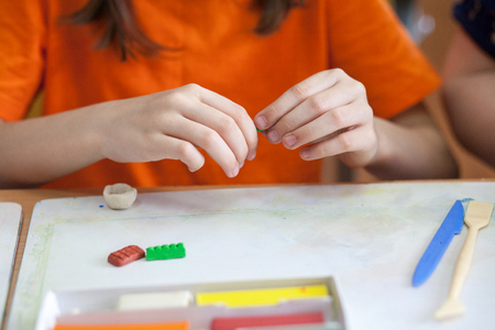 pupils modeling in plasticine in clasroom