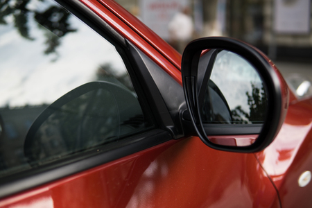 Side mirror of modern car, closeup Standard-Bild
