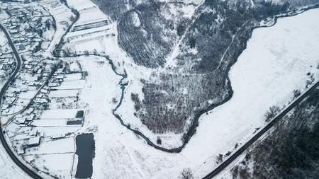 Winter Aerial view over the small village. Winter landscape. Moldova.