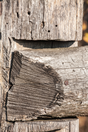 Close-up of the silver wooden old fence laths on black background