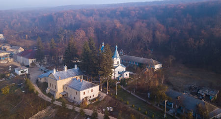 Aerial view The l Thiganeshty Monastery in fog. Autumn landscape. Moldova.