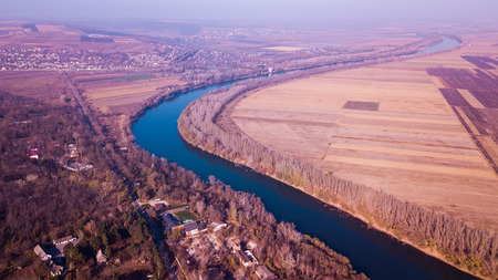 Aerial view of the river on a sunny day of autumn. Dniester river, Moldova republic.