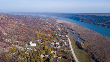Aerial view of the camera over the Orthodox Church and little village in Moldova republic. Stock Photo