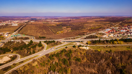 Aerial view drone video of a highway. Drone flies forwards while traffic moves underneath.