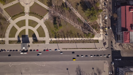 Aerial view of the avenue where many cars movie. A view from above of a highway of the big city.