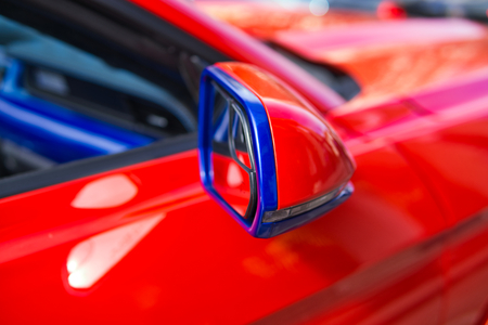 The image Red car side mirror integrated with signal lamp