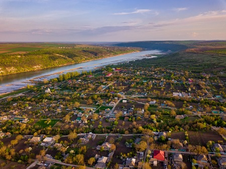Arial view over the river and small village. Dniester river of Moldova republic.
