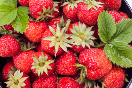 Fresh organic strawberry on background, tasty strawberry fruit for sale in market Close up.