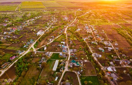 Flight over a little village at sunset. European village. Moldova republic