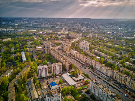 Aerial drone view of Kishinev city in green spring at sunset, Moldova