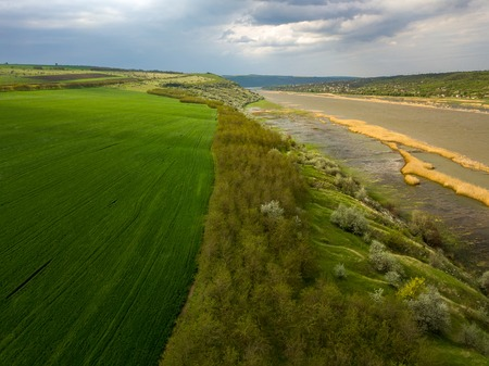 Flight over the river and forest at spring time. Dniester river of Moldova republic.