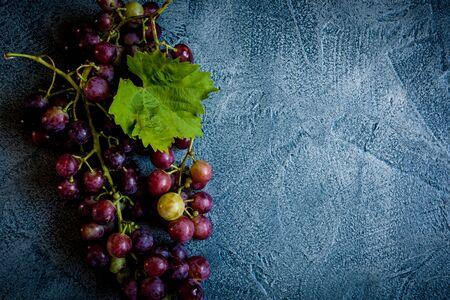 Grape on vintage blue background Reklamní fotografie - 124656785