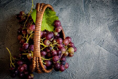 Grapes in the babasket on wintage background