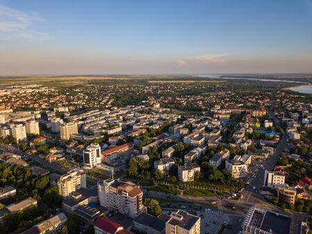 Aerial view of Slatina city and river Olt, Romania. Drone flight over the european city in summer day.