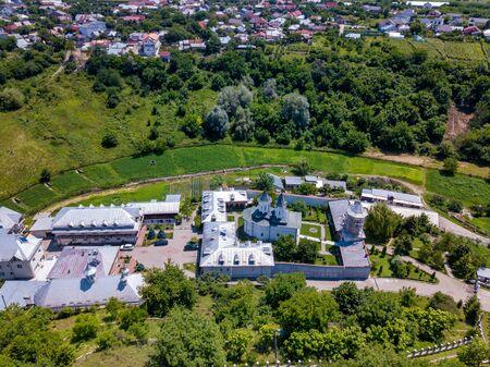 Aerial view of the Orthodox Christian monastery in the city of Slatina, Romania. Clocochiov monastry. 写真素材 - 128772600