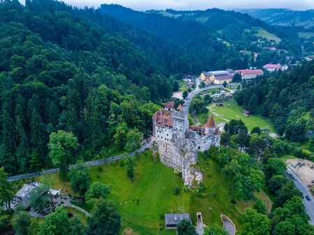Aerial panorama view of the medieval Bran Castle, known for the myth of Dracula , Dracula Castle in Brasov, Transylvania. Romania. Фото со стока