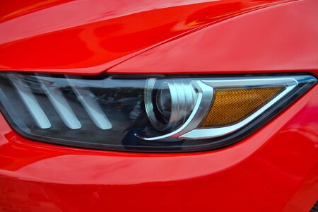 Closeup of new projector headlight on the modern car. Stok Fotoğraf - 129646955