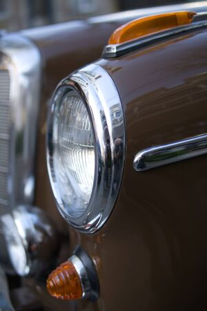 A fragment of a retro car in close-up. Headlights and rider.