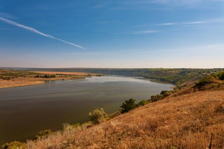 Beautiful autumn landscape with a river in the early morning, The Dniester river in Moldova near the village of Molovata Foto de archivo