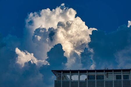 Modern building against the sky with thunderclouds